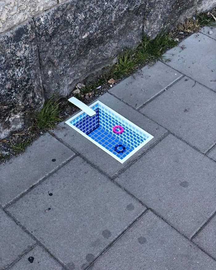 Artista sueco espalha sua impressionante arte Pixel pela cidade 23
