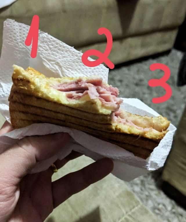 Como você morde um sanduíche oferecido por outra pessoa