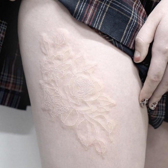 24 tatuagens que provam que o branco é o novo preto 13