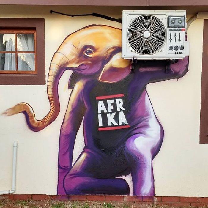 Artista sul-africano pinta grafites incríveis que interagem com o ambiente (32 fotos) 14