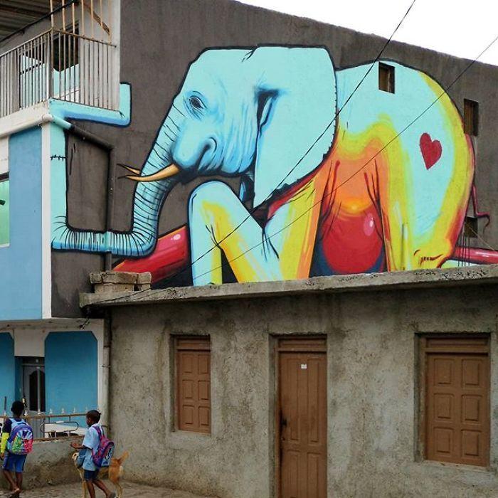 Artista sul-africano pinta grafites incríveis que interagem com o ambiente (32 fotos) 24