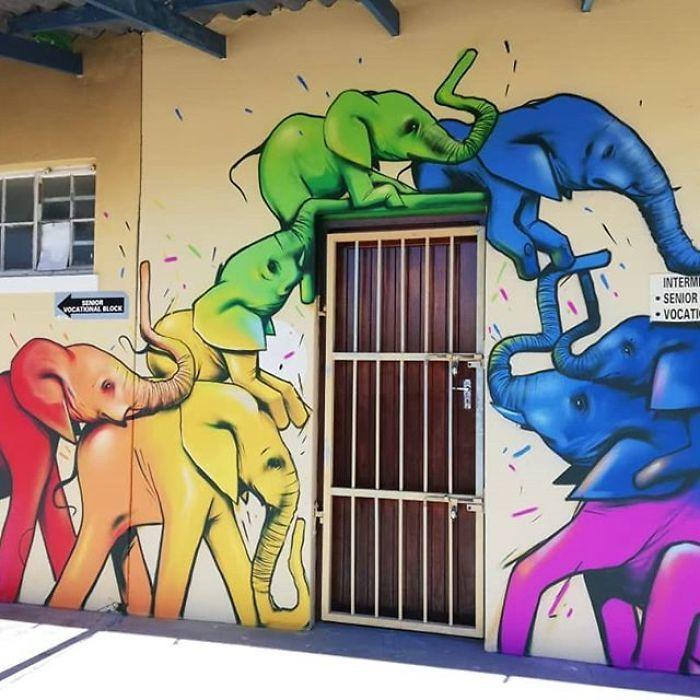 Artista sul-africano pinta grafites incríveis que interagem com o ambiente (32 fotos) 28