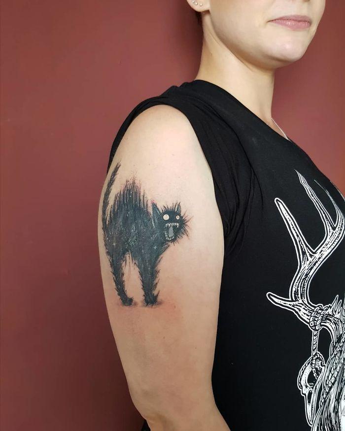 45 pessoas que fizeram tatuagens absolutamente incríveis de gatos 8