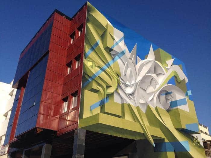 Artista cria obra surreais que parecem mudar a forma dos imóveis 3