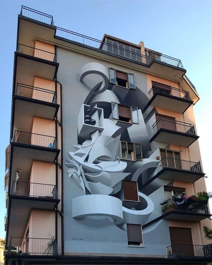 Artista cria obra surreais que parecem mudar a forma dos imóveis 15