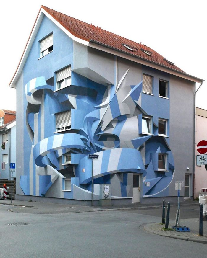 Artista cria obra surreais que parecem mudar a forma dos imóveis 16