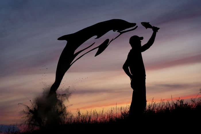 Este artista recorta papelão para criar obras mágicas ao pôr do sol 35