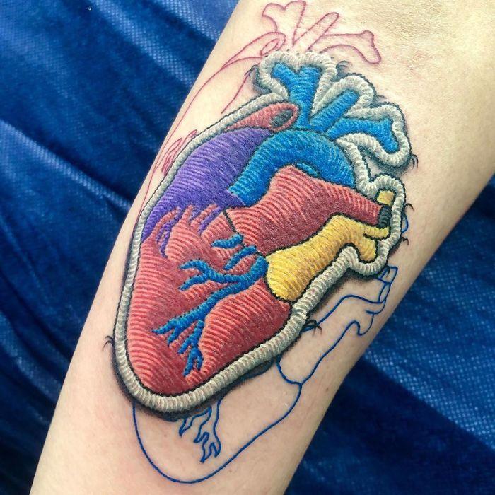 Artista cria tatuagens que parecem remendos costurados e aqui estão 44 de suas obras mais impressionantes 43