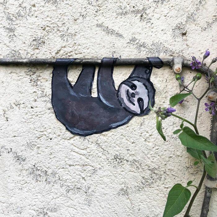 Artista francês espalha humor em espaços urbanos por meio de sua arte 17