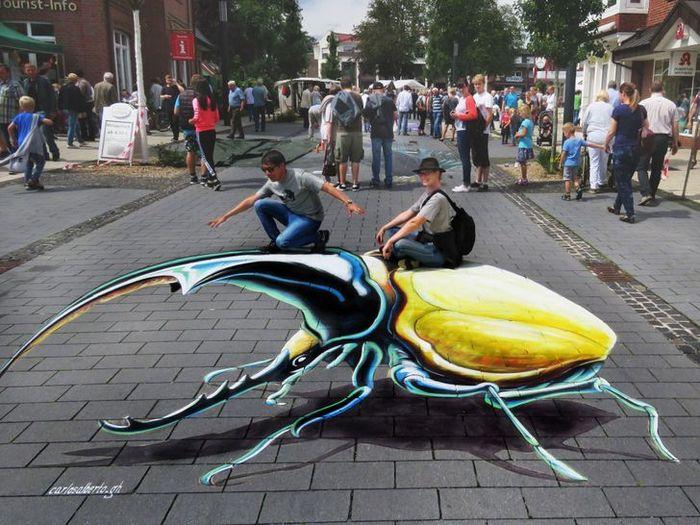 Um artista ilumina ruas com sua arte em 3D, tão mágica que vai fazer você questionar a realidade 9