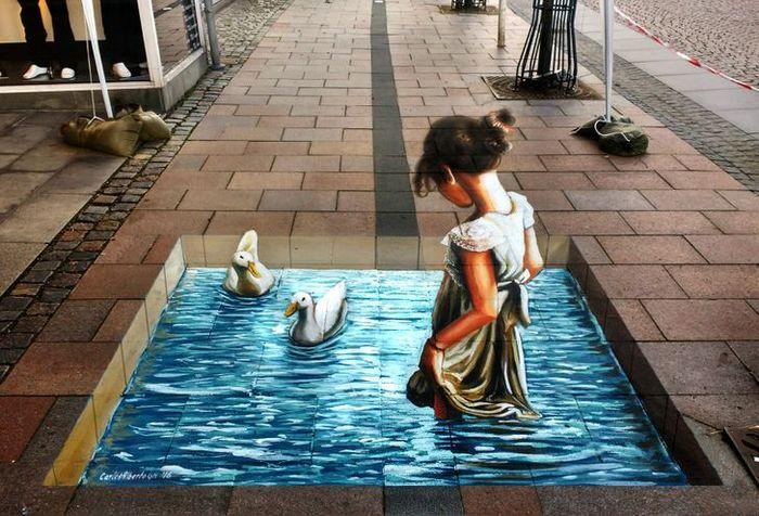 Um artista ilumina ruas com sua arte em 3D, tão mágica que vai fazer você questionar a realidade 11