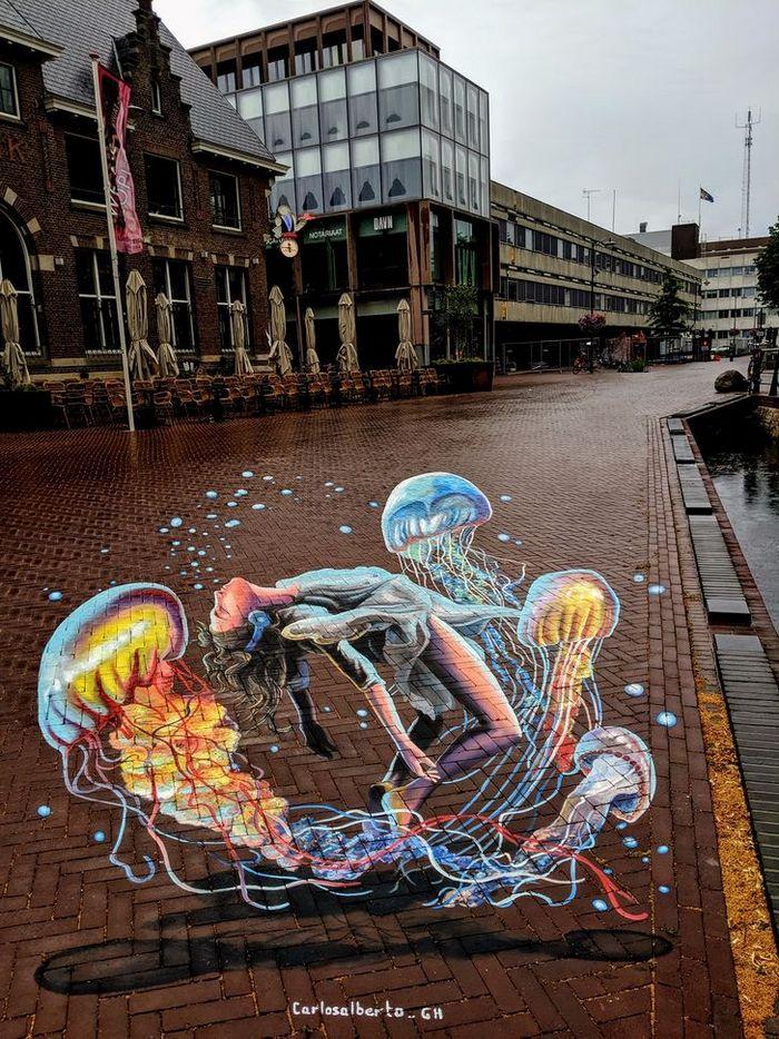 Um artista ilumina ruas com sua arte em 3D, tão mágica que vai fazer você questionar a realidade 17