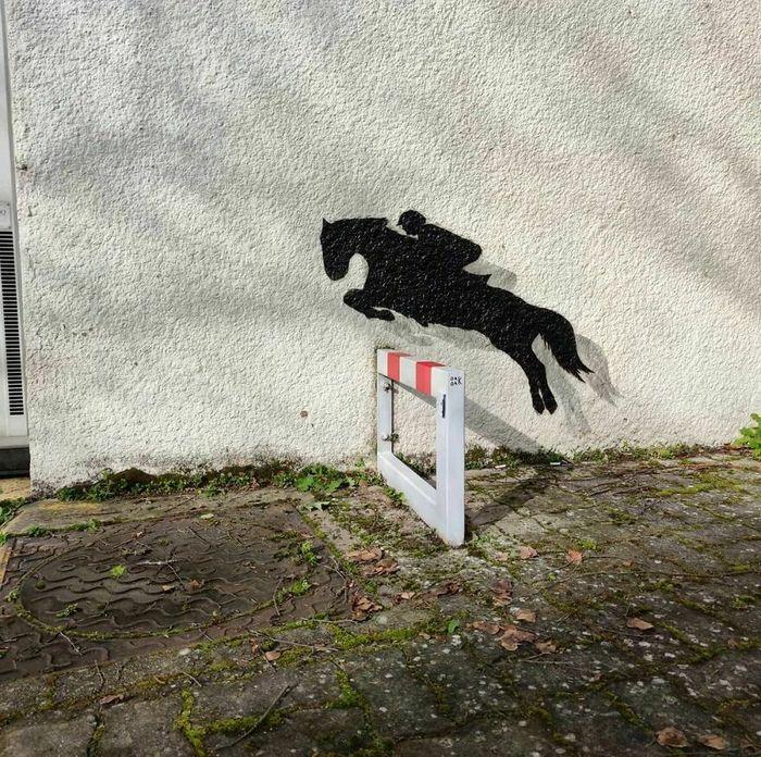 Artista francês cria arte humorística nas ruas de Paris 6