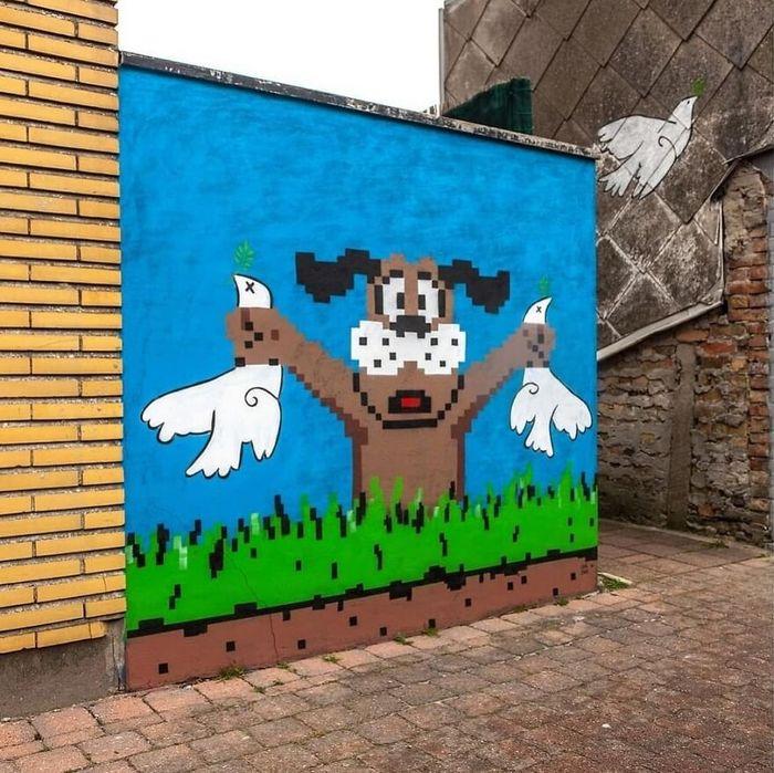 Artista francês cria arte humorística nas ruas de Paris 15