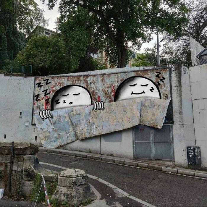 Artista francês cria arte humorística nas ruas de Paris 34