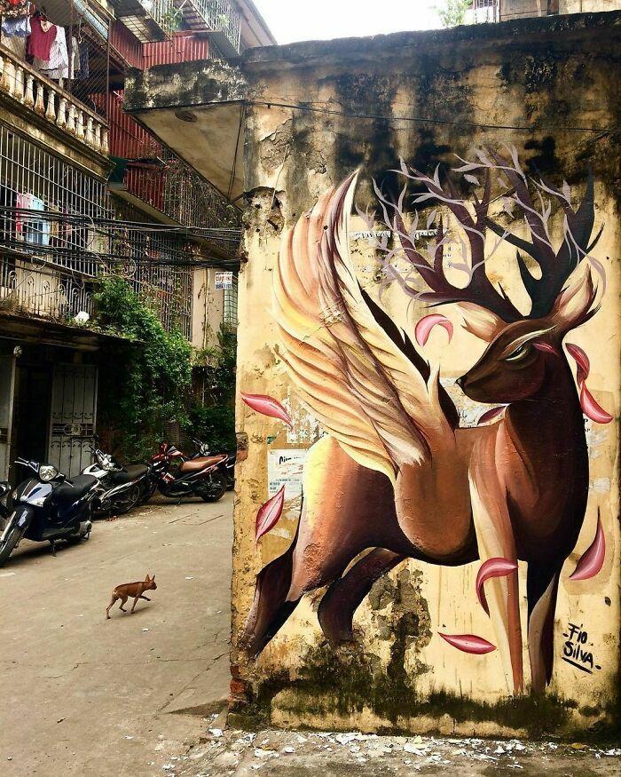 32 edifícios decorados com hipnotizantes murais de vida selvagem 10