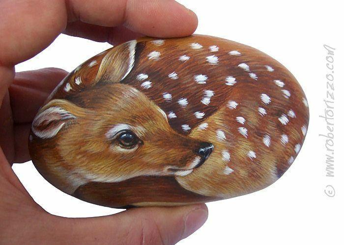Artista transforma pedras em pinturas incríveis de animais (30 fotos) 23